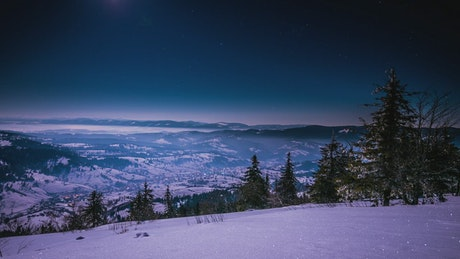 Moon light in the winter mountains