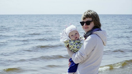 Mother and baby at the beach