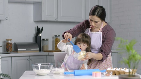 Mother and child baking in the kitchen