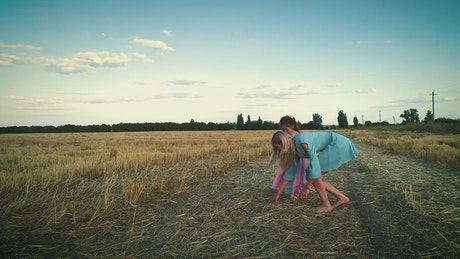 Mother and daughter playing in the countryside