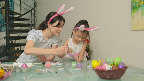 Mother and daughter preparing easter eggs