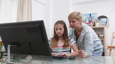 Mother and daughter working at the computer