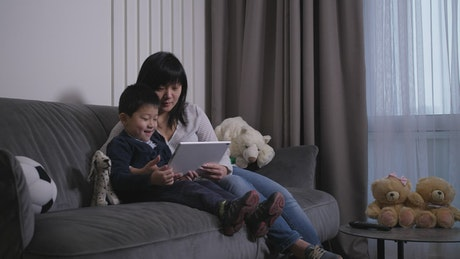 Mother and her Son viewing a tablet