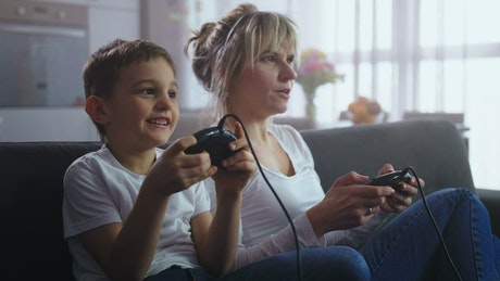Mother and son playing an old console