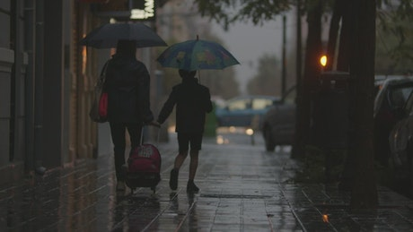 Mother and son walking in the rain