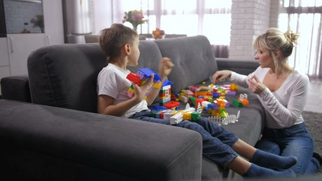 Mother building blocks with her son