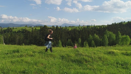 Mother takes photos of her daughter in nature