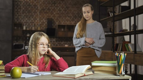 Mother talking to her daughter about school