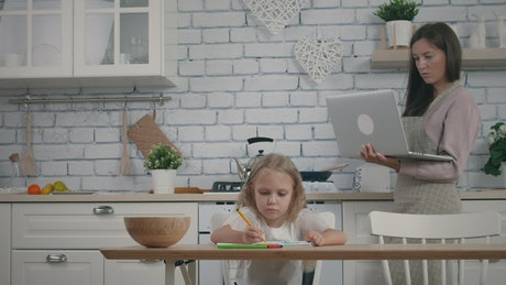 Mother working at home and cooking