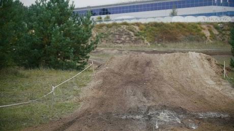 Motocross racer landing on dirt
