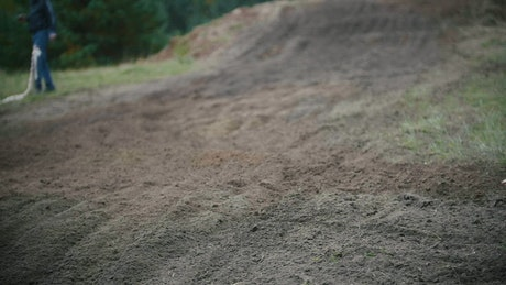 Motocross racer moving up a dirt hill