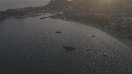 Motorboats, yachts and ships sailing near a beach