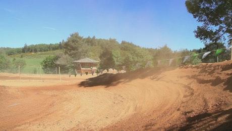 Motorcross rider kicking up dirt