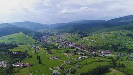 Mountain village in spring, aerial landscape