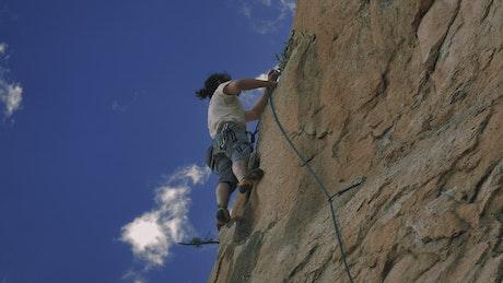 Mountaineer climbing on top of a mountain