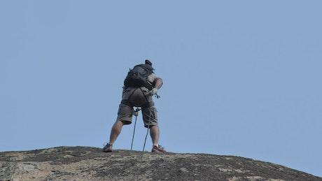 Mountaineer descending a rocky slope