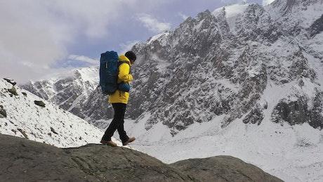 Mountaineer walking on winter mountains