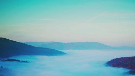Mountainous autumn landscape covered in mist