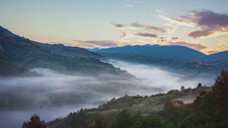 Mountainous valley during sunrise, time-lapse