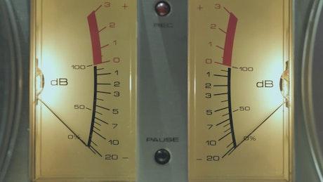 Moving needle on retro audio tape recorder