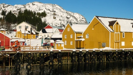 Multi colored wooden fishing houses and pier