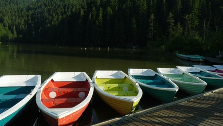Multicolor boats in the lake pier