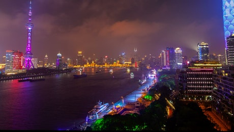 Multicolor city lights in Shanghai by the river