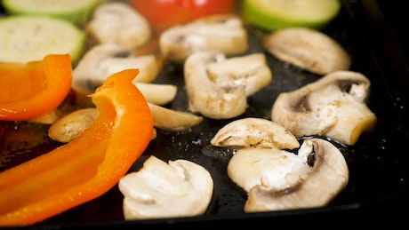Mushrooms and peppers in oil