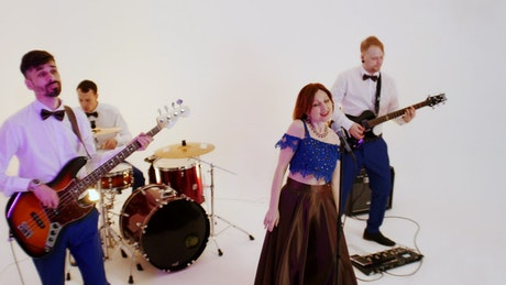 Musical band playing a song on a photo studio