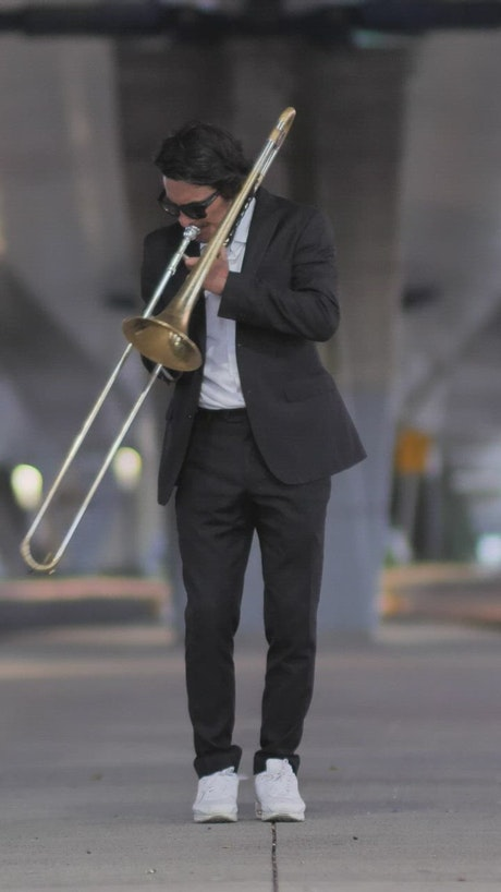 Musician dressed in black suit at the street