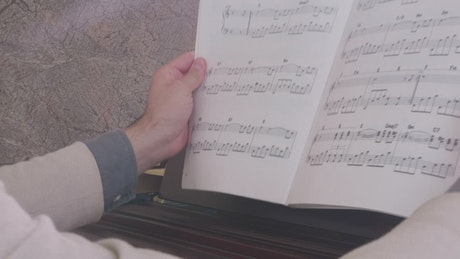 Musician looking for a page in a score book
