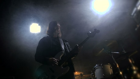 Musician playing a guitar in a small club