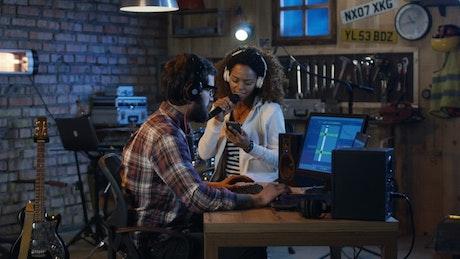 Musicians recording voice in a home studio