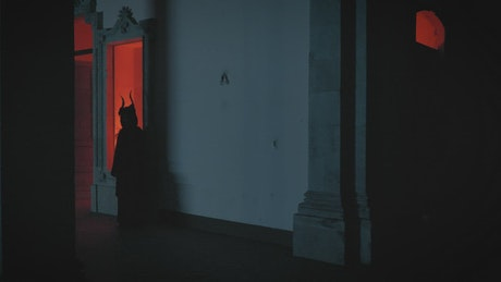 Mysterious people in robes in an old building at night