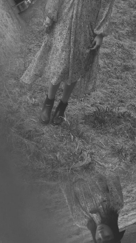 Mysterious woman walking in a forest in black and white