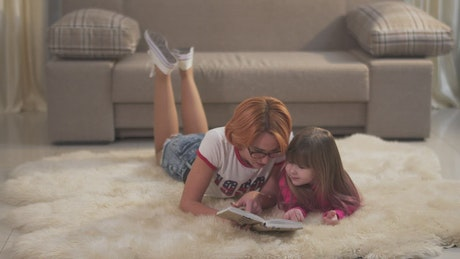 Nanny reads a story to a girl