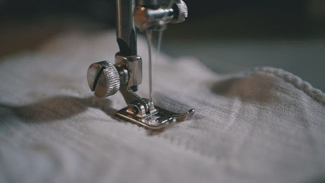 Needle sewing in slow motion