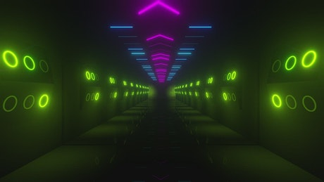 Neon lights in tunnel walls with a gate at the end