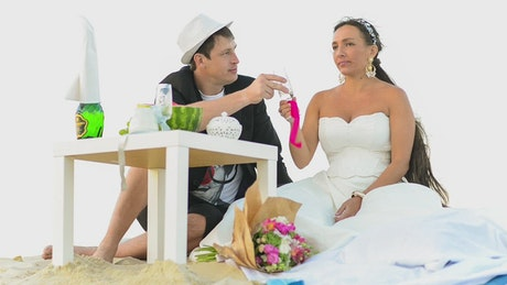 Newlyweds on a picnic on the beach
