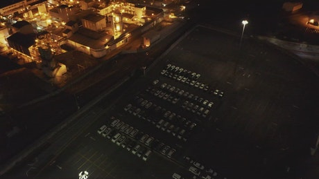 Night factory reveal, aerial view