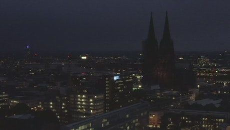 Night flight in a German city with a cathedral