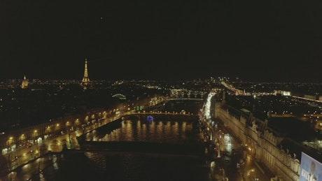 Night flight over the Seine river in Paris