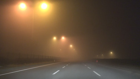 Night fog in the city highway