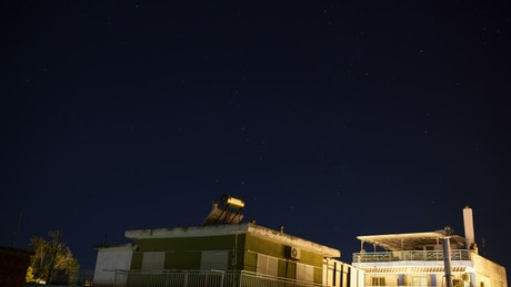 Night sky above small houses