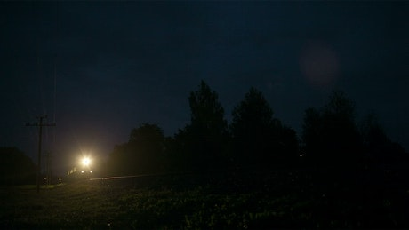 Night train heading through the countryside