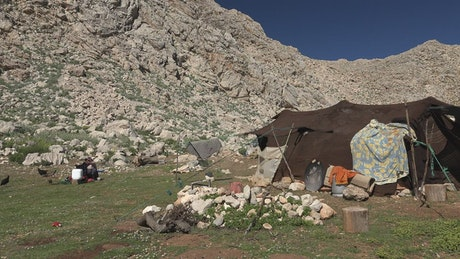 Nomad and tent in the top of the mountain