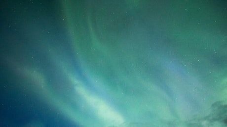 Northern Lights of blue and green colors in the night sky