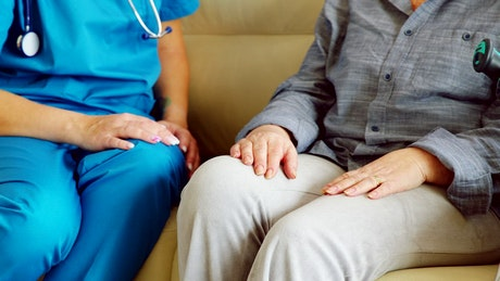 Nurse gives woman hope by holding hands