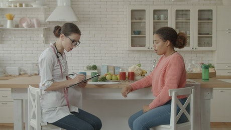 Nutritionist in a kitchen consultation