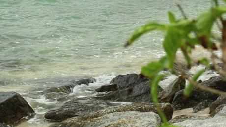 Ocean waters breaking on rocks